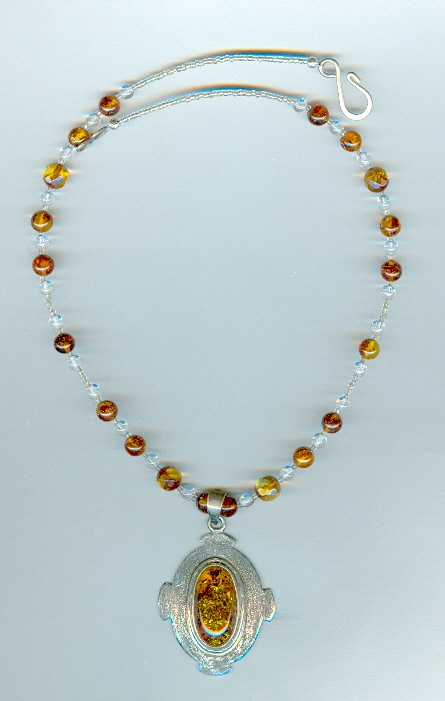 name large oval sterling silver and cognac amber pendant