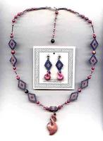 Raspberry Double Flip Jewelry Set: Carved Rhodonite and Needlework
