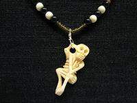 Carved Skeleton Pendant Necklace: Bad to the Bone