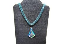 Long Bead Knitted Necklace with Dichroic Glass Peacock Swirl Pendant