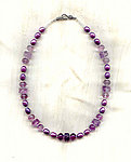 Polynesian Sunset Necklace: Purple Pearls and Carved Fluorite Beads