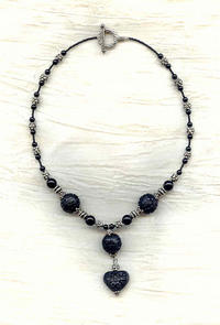 LOVE AT MIDNIGHT: Carved Black Cinnabar Pendant Necklace