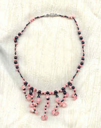 PINK HIBISCUS JABOT NECKLACE: Black Onyx and Carved Pink Coral