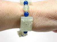 Bracelet of Handcarved Serpentine and Blue Onyx Beads